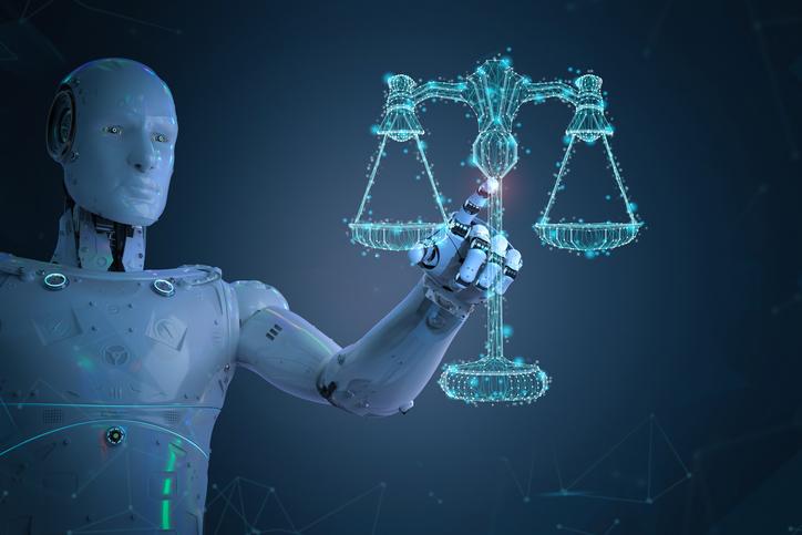 Un robot tiene in mano una bilancia fatta con bit